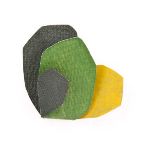 Cactus brooch made of oxidized sterling silver and yellow and green enamel paint featuring abstract botanical forms