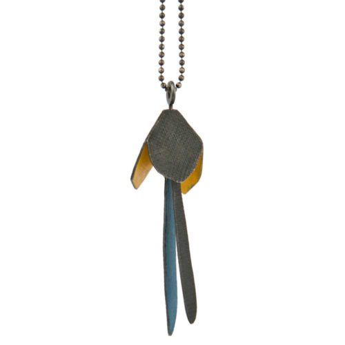 Oxidized silver flower necklace with yellow and blue details strings along a silver chain like a botanical charm