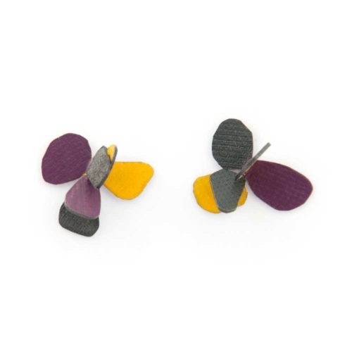 Violet flower earrings made of oxided silver and purple and yellow enamel paint featuring flower petals and abstract botanical motifs