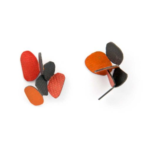 Colorful jewelry hive earrings made of oxidized sterling silver and red and orange enamel paint featuring cascading butterflies.