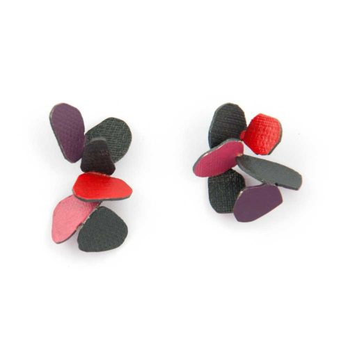 Butterfly earrings made of oxidized sterling silver and red, pink, and purple enamel paint featuring a cascading hive.