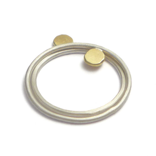 geometric ring set, featuring 5 different shaped bruched silver rings with each of them an 18K golden dot