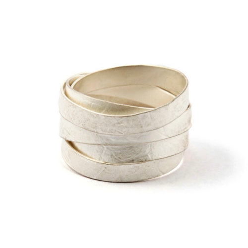 silver wrap around ring of bleached silver with leaf imprint that wraps around your finger eight times