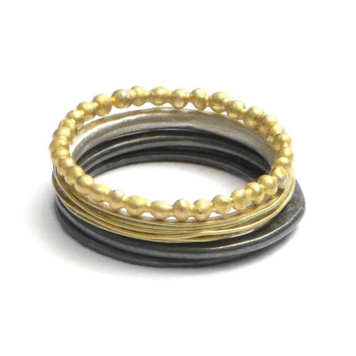 stacking ring in oxidized silver and 18k gold