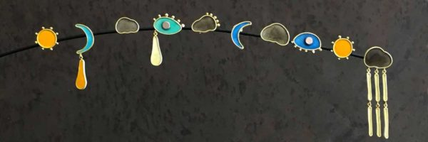 a collection of single enamel stud earrings to mix and match your own pair. Clouds, sun, moon and eye shaped.
